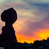Balanced Rock silhouetted at sunset.