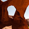 A Navajo flute player at Spiderweb Arch near Monument Valley.
