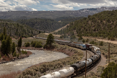 Amtrak's California Zephyr and a freight train along the Colorado River near Radium, Colorado, on April 26, 2019. Photo by Mitch Tobin/The Water Desk