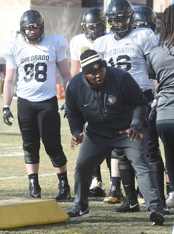 . Kwahn Drake works with the defensive linemen on Wednesday.  For more photos, go to Buffzone.com, Cliff Grassmick  Photographer  February 28, 2018