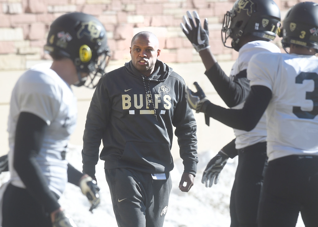 . Assistant coach, Ashley Ambrose, works with defensive backs on Wednesday. For more photos, go to Buffzone.com, Cliff Grassmick  Photographer  February 28, 2018