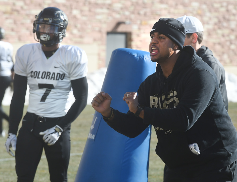 . CU Assistant, Shadon Brown, works with safeties at the Wednesday practice. For more photos, go to Buffzone.com, Cliff Grassmick  Photographer  February 28, 2018