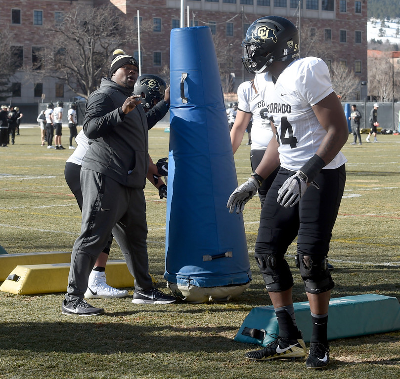 . Kwahn Drake,  left,  works with the defensive linemen on Wednesday. For more photos, go to Buffzone.com, Cliff Grassmick  Photographer  February 28, 2018