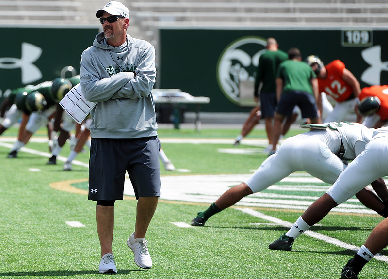 Colorado State head football coach Mike Bobo observes his team before a scrimmage Saturday, Aug. 4, 2018 at Canvas Stadium in Fort Collins, Colorado. (Sean Star/Loveland Reporter-Herald)