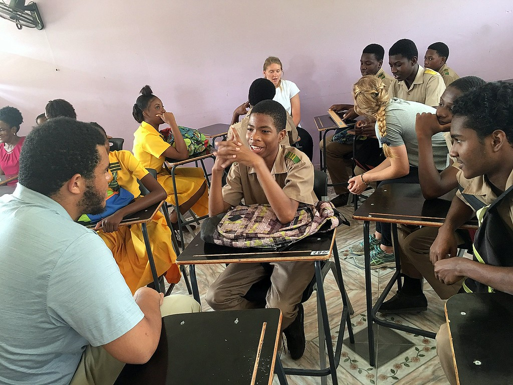 . Members of the CSU Green and Global group have one-on-one chats with students at Petersfield High School in Jamaica. (CSU Green and Global)