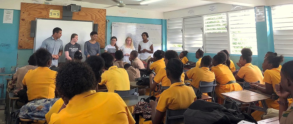 . Adam Prentice, Veronica Morin, Marlee Brown, Sarah Muzik, Ally Murphy Pauletto and Jessica Jackson speak to a class of students at Petersfield High School in Jamaica. (CSU Green and Global)