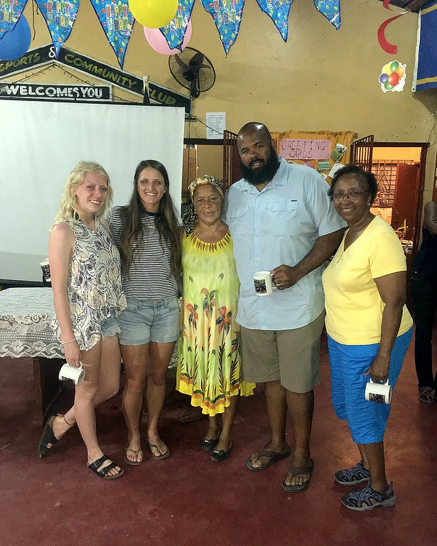 . Ally Murphy Pauletto, Sarah Muzik, Brenda Spence, Albert Bimper and Blanche Hughes pose at the Association of Club, where the CSU Green and Global group met every night. Spence served as Murphy Pauletto\'s host mother during her trip. (CSU Green and Global)