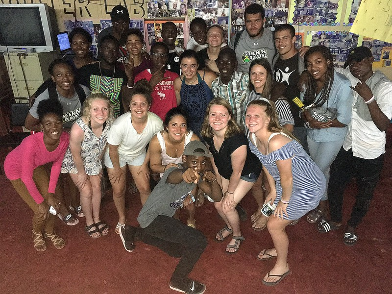 The student-athletes from Colorado State's Green and Global program pose with friends they made at the Association of Clubs buildinig in Petersfield, Jamaica. (CSU Green and Global)