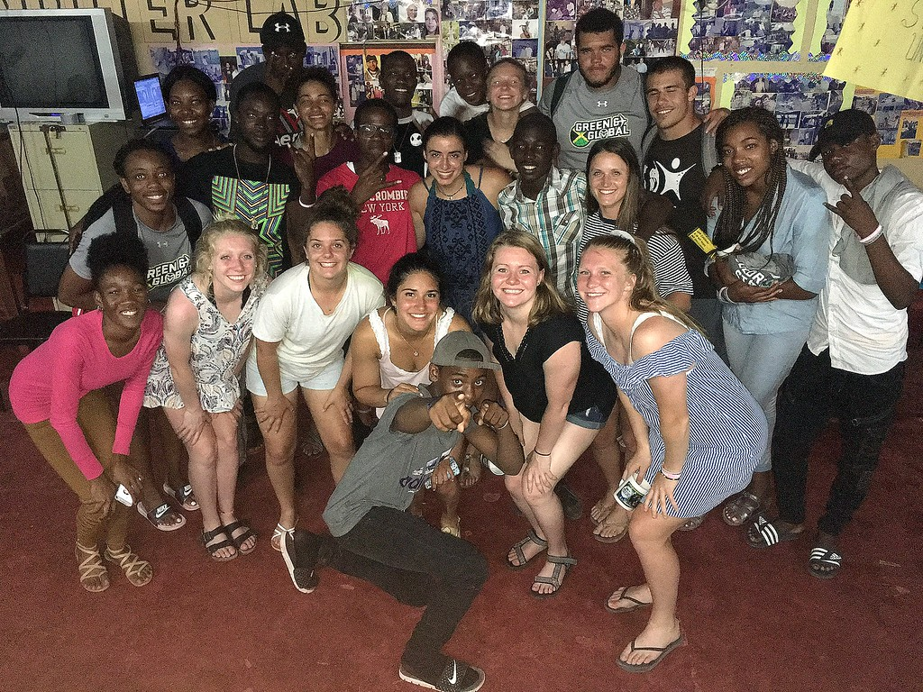 . The student-athletes from Colorado State\'s Green and Global program pose with friends they made at the Association of Clubs buildinig in Petersfield, Jamaica. (CSU Green and Global)