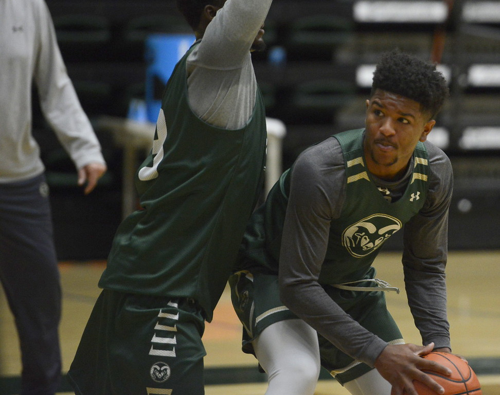 . Prentiss Nixon posts up against Raquan Mitchell during a Colorado State men\'s basketball practice on Friday at Moby Arena.