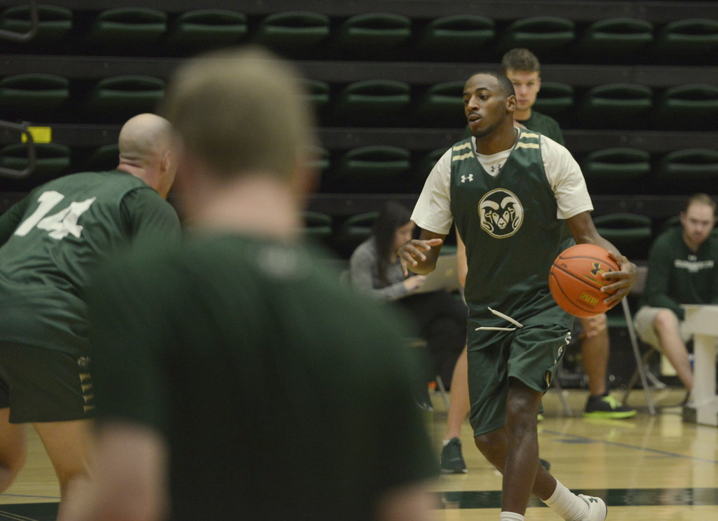 . J.D. Paige dribbles against the defense of Robbie Berwick during a Colorado State men\'s basketball practice on Friday at Moby Arena.
