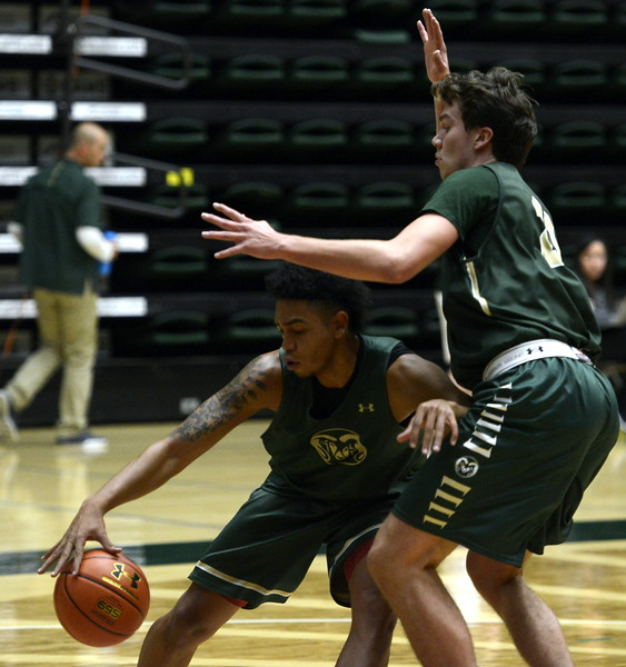 Lorenzo Jenkins posts up against Logan Ryan during a Colorado State men's basketball practice on Friday at Moby Arena.