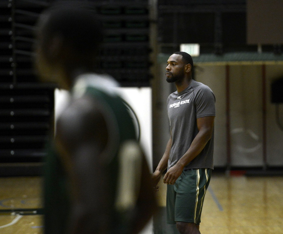 . Grad assistant Tiel Daniels watches warmups during a Colorado State men\'s basketball practice on Friday at Moby Arena.