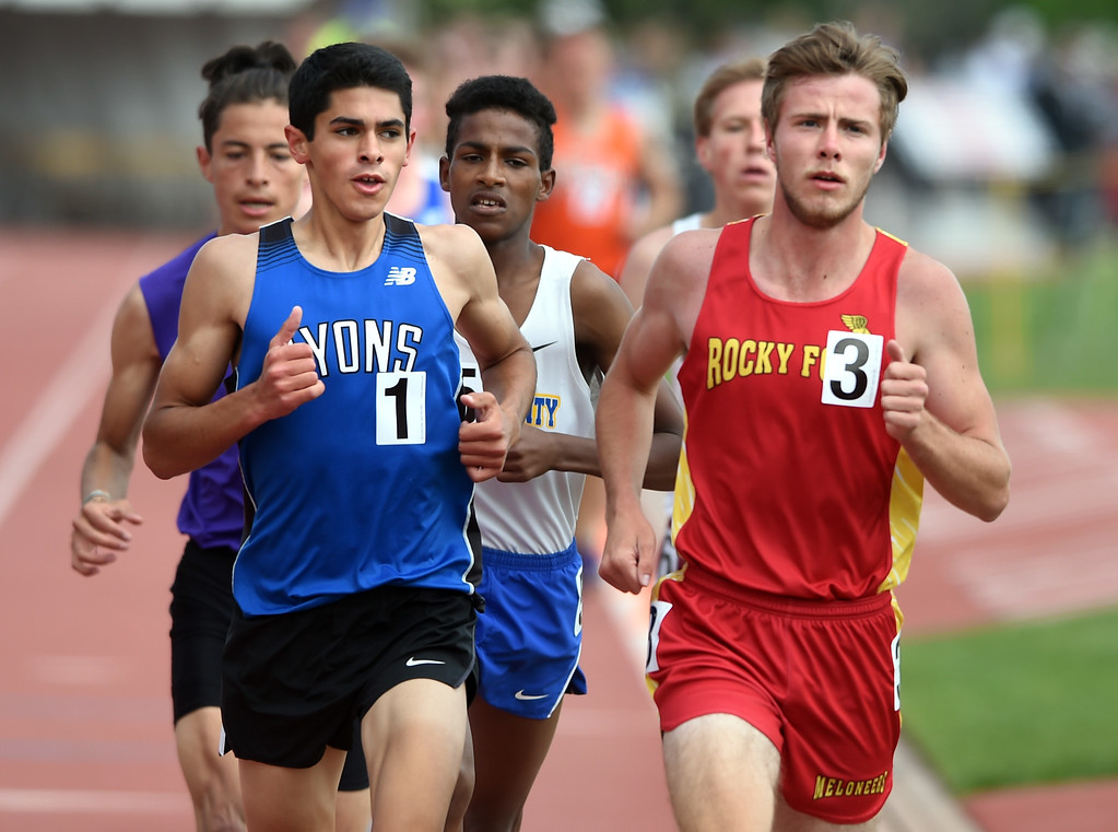 . Isaac Roberts, left, of Lyons, and Cody Danley, of Rocky Ford, battle in the 2A 3200 meters during Colorado State Track and Field in Lakewood on Friday. For more photos, go to BoCoPreps.com.  Cliff Grassmick / Staff Photographer/ May 18, 2018