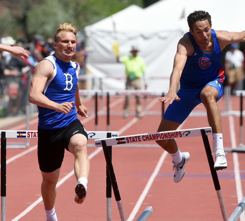 . Mitchell Gorman, left, of Broomfield and Oscar Sarabia, battle the hurdles during Colorado State Track and Field in Lakewood on Friday. For more photos, go to BoCoPreps.com.  Cliff Grassmick / Staff Photographer/ May 18, 2018