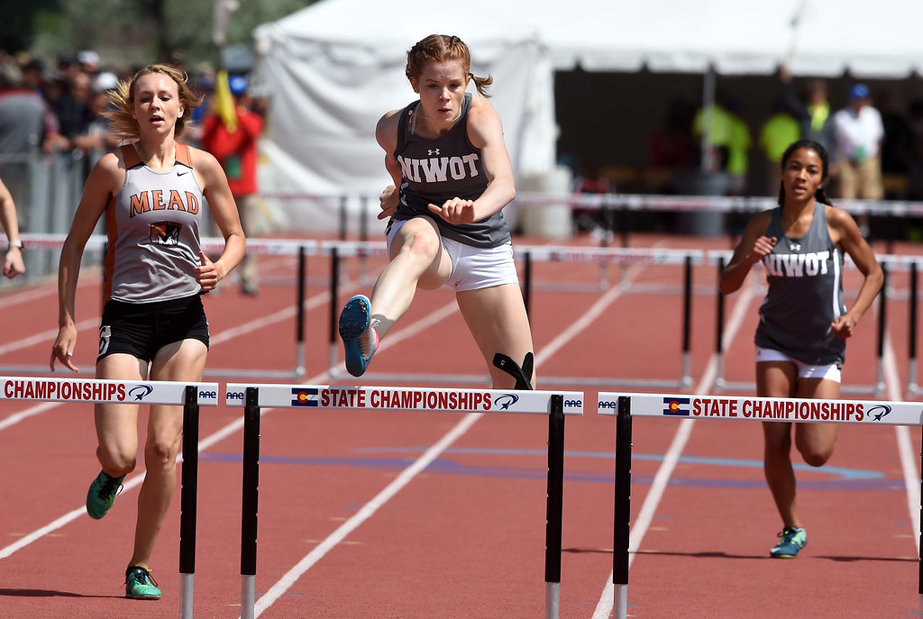 . Mary Gillett, center, of Niwot, wins the 300 meters hurdles prelim during Colorado State Track and Field in Lakewood on Friday. For more photos, go to BoCoPreps.com.  Cliff Grassmick / Staff Photographer/ May 18, 2018