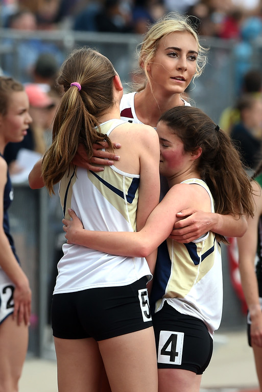 . Soliel Gaylord, of Telluride, hugs Helen Cross and Sarah Davidson, of Nederland, after she won the 2A 3200 meters during Colorado State Track and Field in Lakewood on Friday. For more photos, go to BoCoPreps.com.  Cliff Grassmick / Staff Photographer/ May 18, 2018