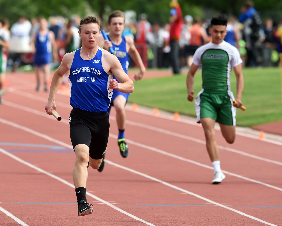 . Samuel Barnett, of Resurrection Christian, in the 4X100 relay during Colorado State Track and Field in Lakewood on Friday. For more photos, go to BoCoPreps.com.  Cliff Grassmick / Staff Photographer/ May 18, 2018