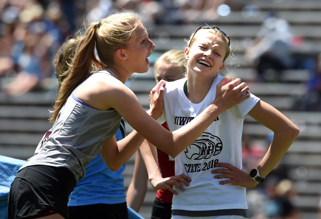 . Rylee Anderson, left, of Silver Creek, and Taylor James, of Niwot, share a laugh after the 4A high jump during Colorado State Track and Field in Lakewood on Thursday. For more photos, go to BoCoPreps.com.  Cliff Grassmick / Staff Photographer/ May 17, 2018