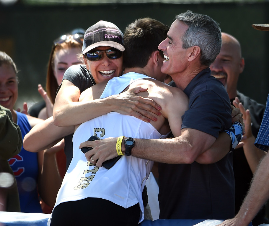 . Max Manson, of Monarch, is hugged by his mother, Amy, and father, Pat, after winning the 5A state pole vault during Colorado State Track and Field in Lakewood on Thursday. For more photos, go to BoCoPreps.com.  Cliff Grassmick / Staff Photographer/ May 17, 2018