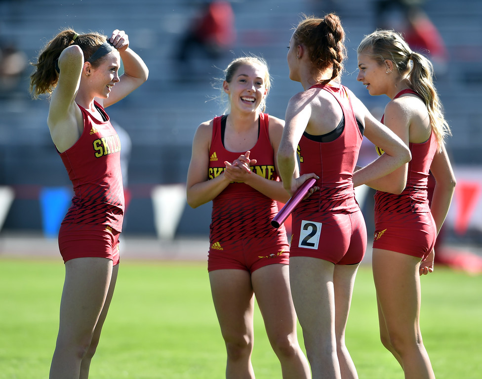 . The Skyline girls talk about their relay race during Colorado State Track and Field in Lakewood on Thursday. For more photos, go to BoCoPreps.com.  Cliff Grassmick / Staff Photographer/ May 17, 2018