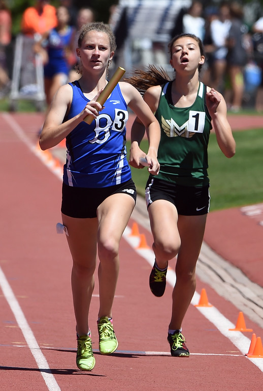. Madison Mooney, of Broomfield, takes the lead in the 5A 4X800 relay to win the state championship during Colorado State Track and Field in Lakewood on Thursday. For more photos, go to BoCoPreps.com.  Cliff Grassmick / Staff Photographer/ May 17, 2018