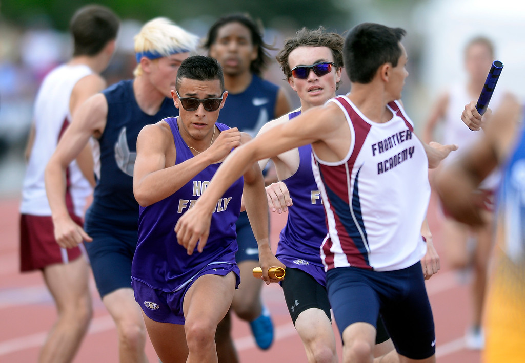 . Holy Family High School\'s Christian Montoya takes the handoff in the 3A 4x800-meter race during the CHSAA State Track & Field Championships on Thursday at the Jeffco Stadium in Lakewood. Holy Family finished 3rd. More photos: BoCoPreps.com Jeremy Papasso/ Staff Photographer 05/17/2018