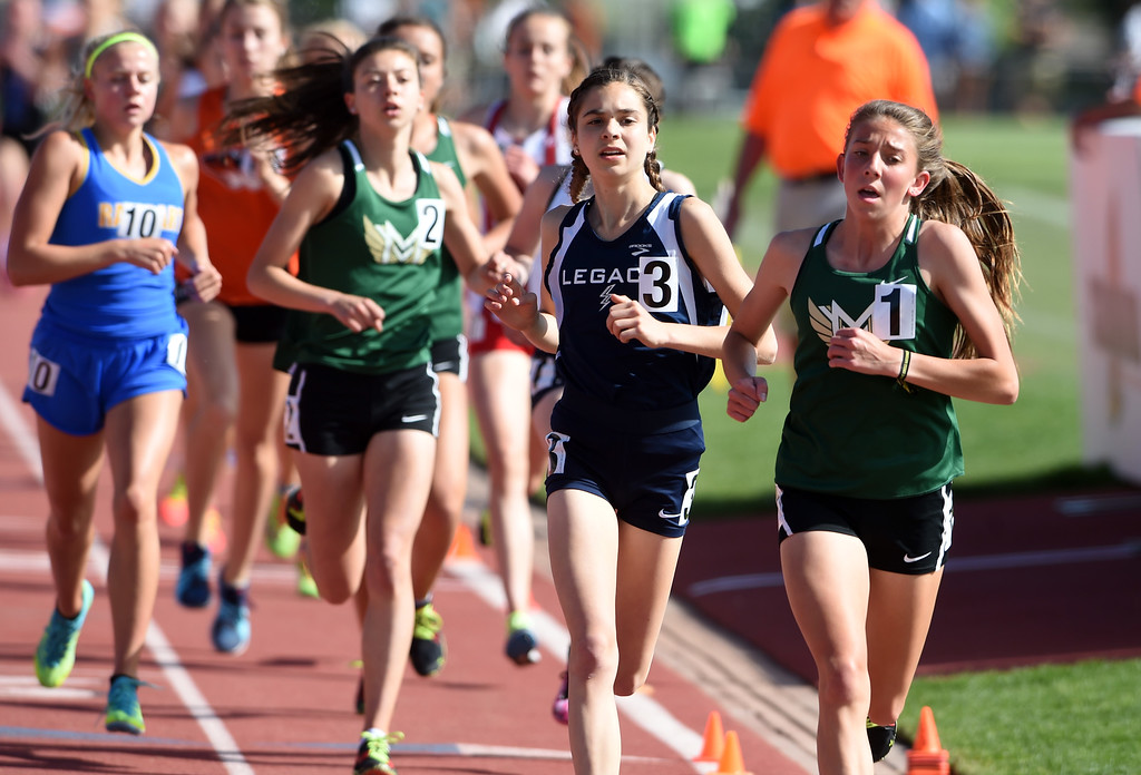 . Brynn Siles, center, of Legacy, finishes second to Jenna Fitzsimmons, right, of Mountain Vista, during the 5A 3200 meters at theduring Colorado State Track and Field in Lakewood on Thursday. For more photos, go to BoCoPreps.com.  Cliff Grassmick / Staff Photographer/ May 17, 2018