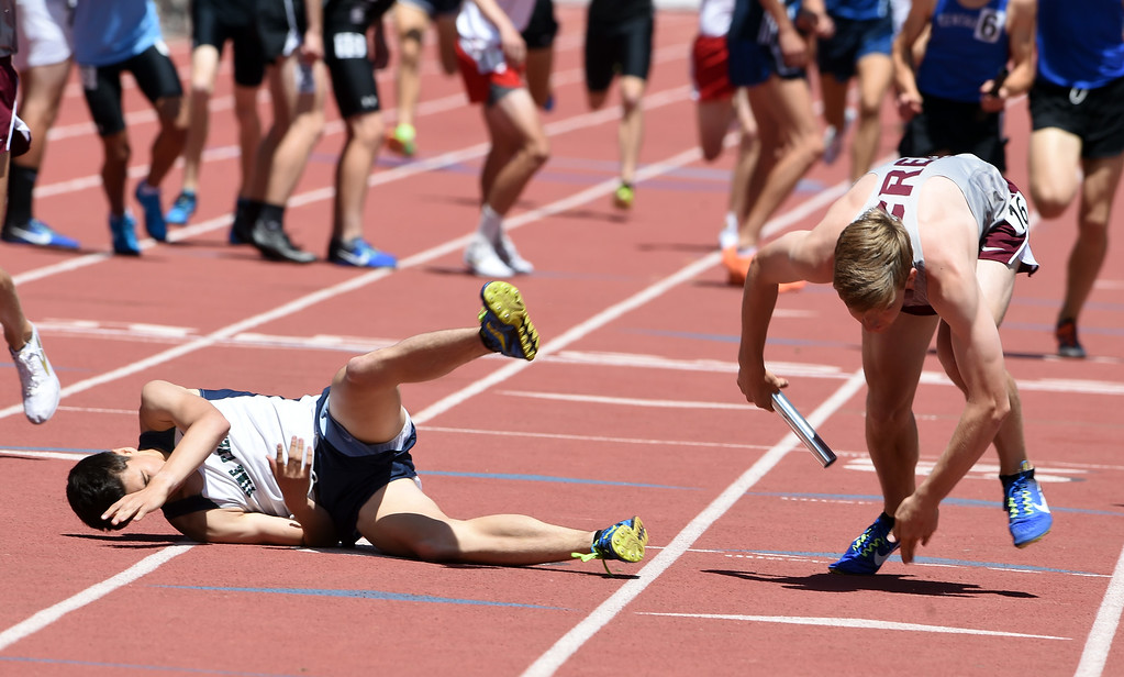 . There was a collision during the finals of the 4X800 relay  race during Colorado State Track and Field in Lakewood on Thursday. For more photos, go to BoCoPreps.com.  Cliff Grassmick / Staff Photographer/ May 17, 2018