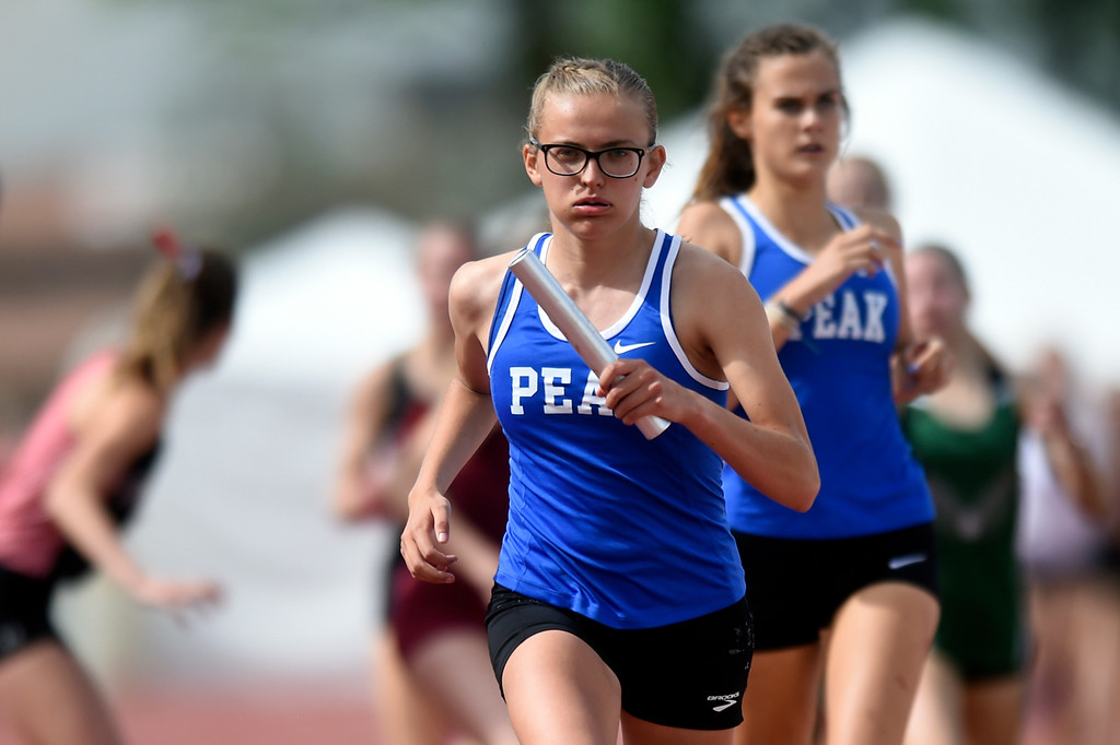 . Peak to Peak Charter School\'s Jenna Howard competes in the girls 4x800 relay during the CHSAA State Track & Field Championships on Thursday at the Jeffco Stadium in Lakewood. Peak to Peak won the championship race. More photos: BoCoPreps.com Jeremy Papasso/ Staff Photographer 05/17/2018
