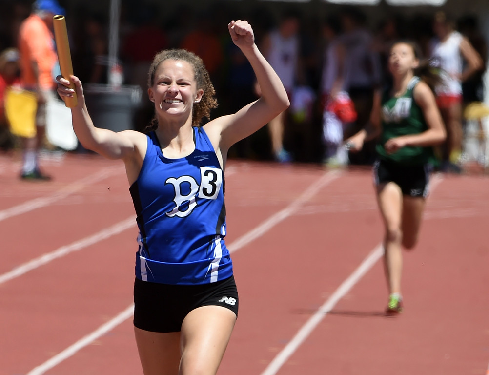 . Madison Mooney, of Broomfield, celebrates the 5A 4X800 relay win during Colorado State Track and Field in Lakewood on Thursday. For more photos, go to BoCoPreps.com.  Cliff Grassmick / Staff Photographer/ May 17, 2018