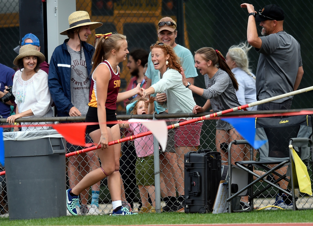 . Shining Mountain Waldorf School\'s Marina Flandrick high fives spectators after clearing the bar in the 2A pole-vaulting event during the CHSAA State Track & Field Championships on Thursday at the Jeffco Stadium in Lakewood. More photos: BoCoPreps.com Jeremy Papasso/ Staff Photographer 05/17/2018