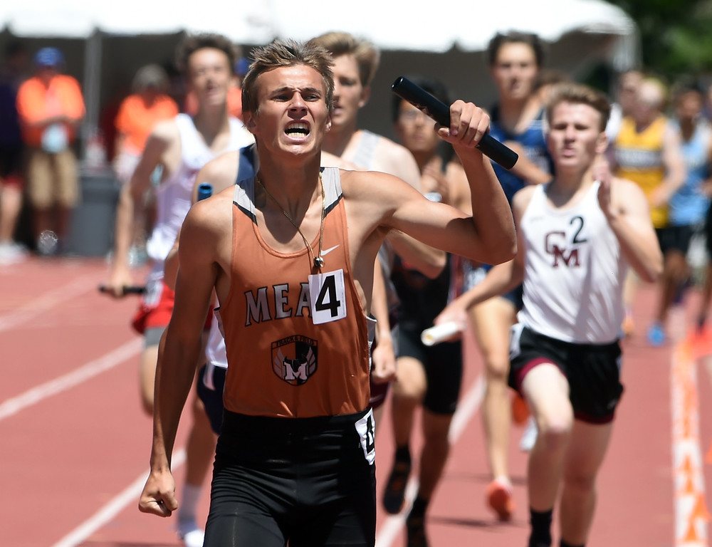 . Hunter Payne, of Mead, anchors the winning team in the 4A 4X800 relay during during Colorado State Track and Field in Lakewood on Thursday. For more photos, go to BoCoPreps.com.  Cliff Grassmick / Staff Photographer/ May 17, 2018