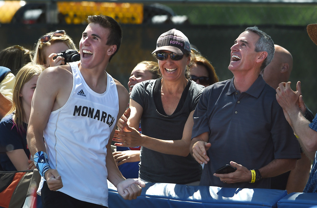 . Max Manson, of Monarch, his mother, Amy, and Father, Pat, watch the cross bar, after winning the 5A state pole vault during Colorado State Track and Field in Lakewood on Thursday. For more photos, go to BoCoPreps.com.  Cliff Grassmick / Staff Photographer/ May 17, 2018