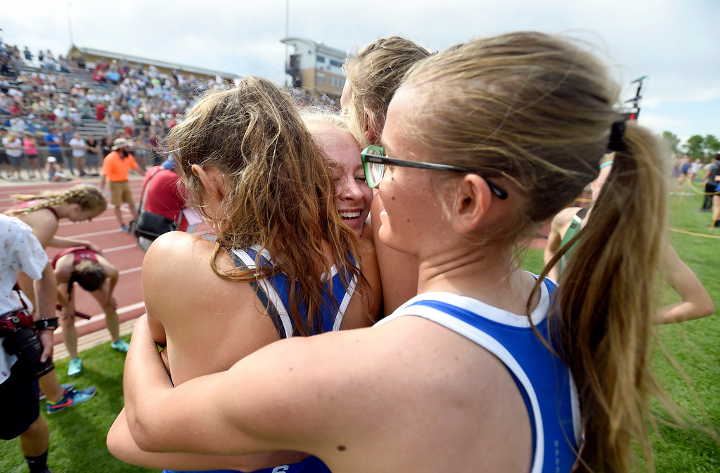 . The Peak to Peak Charter School\'s 4x800 relay team celebrate victory after clenching the state title during the CHSAA State Track & Field Championships on Thursday at the Jeffco Stadium in Lakewood. More photos: BoCoPreps.com Jeremy Papasso/ Staff Photographer 05/17/2018
