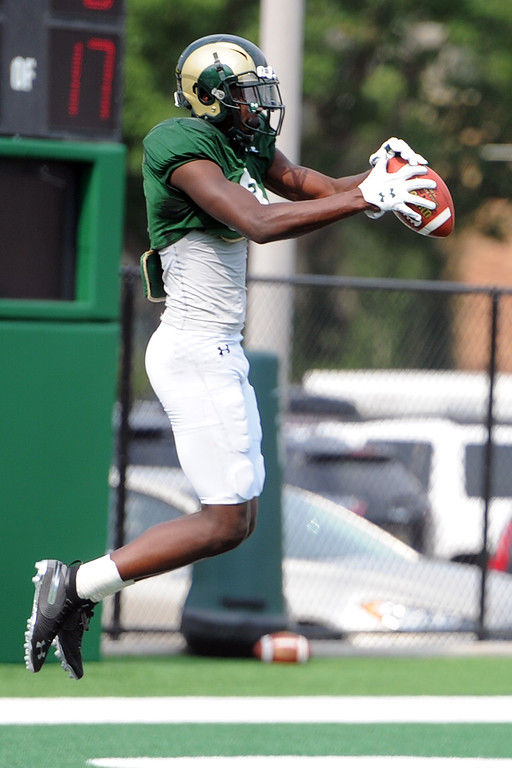 . Colorado State wide receiver Warren Jackson leaps to make a catch during practice Thursday, August 2, 2018 in Fort Collins, Colorado. (Sean Star/Loveland Reporter-Herald)