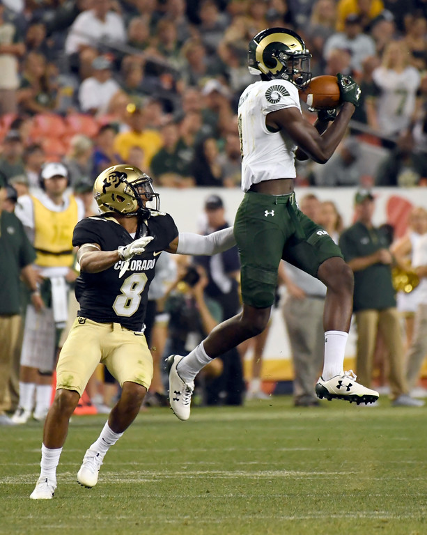 . DENVER, CO - SEPTEMBER  1: Colorado State Rams wide receiver Warren Jackson (9) catches a pass in front of Colorado Buffaloes Trey Udoffia (8) in the fourth quarter during the Rocky Mountain Show down on September 1, 2017 in Denver, Colorado at Sports Authority Field. Udoffia forced a fumble on the play and recovered by the Buffaloes. The Buffaloes defeated the Rams 17-3. (Photo by John Leyba/The Denver Post)