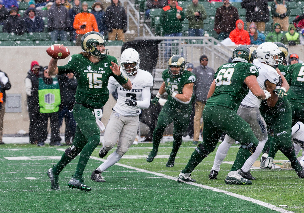. Colorado State quarterback Collin Hill (15) throws against Utah State in a light snowfall Saturday afternoon Nov., 17, 2018 at Canvas Stadium in Fort Collins. (Michael Brian/For the Reporter-Herald)