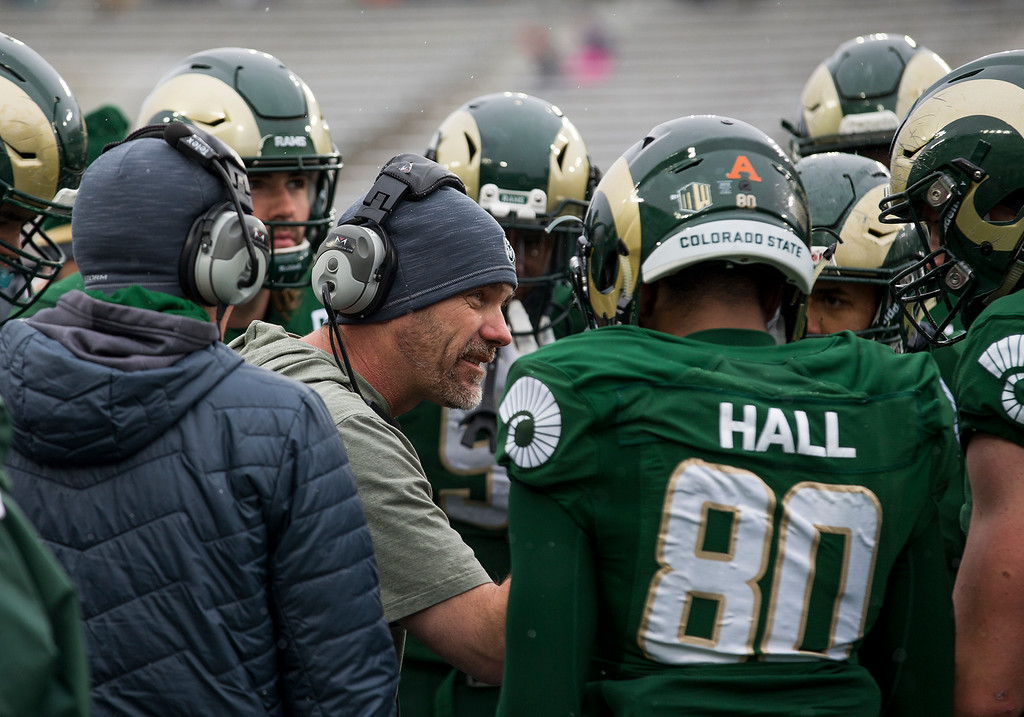 . Colorado State head coach Mike Bobo talks to his players during an early timeout Saturday afternoon Nov., 17, 2018 as the Ram\'s took on the Aggies from Utah State at Canvas Stadium in Fort Collins. (Michael Brian/For the Reporter-Herald)