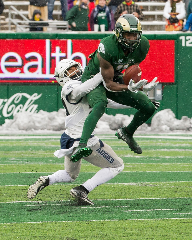 . Colorado State wide receiver Preston Williams (11) catches a deep pass against Utah State cornerback Deante Fortenberry (27) Saturday afternoon Nov., 17, 2018 at Canvas Stadium in Fort Collins. (Michael Brian/For the Reporter-Herald)