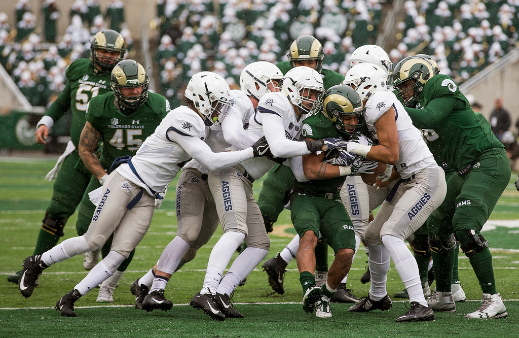 . Colorado State senior running back Izzy Matthews (24) gets stacked up by the Utah State defense Saturday afternoon Nov., 17, 2018 at Canvas Stadium in Fort Collins. (Michael Brian/For the Reporter-Herald)