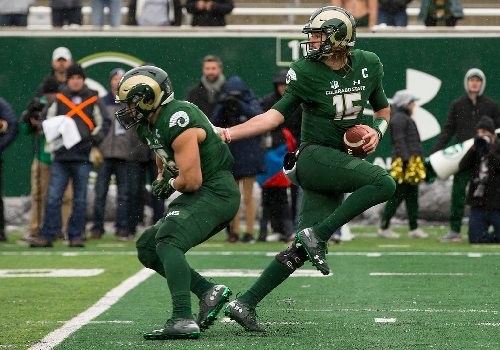. Colorado State quarterback Collin Hill (15) fakes the handoff to fullback Adam Prentice (46) against Utah State Saturday afternoon Nov., 17, 2018 at Canvas Stadium in Fort Collins. (Michael Brian/For the Reporter-Herald)