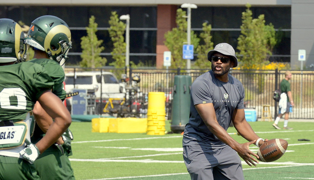 . Colorado State wide receivers coach Alvis Whitted explains a drill to his players during Tuesday\'s practice. (Mike Brohard/Loveland Reporter-Herald)