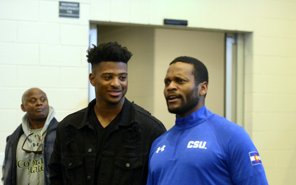. Former Colorado State wideout Rashard Higgins, left, chats with Rams\' wide receivers coach Alvis Whitted prior to pro day on Wednesday. (Mike Brohard/Reporter-Herald)