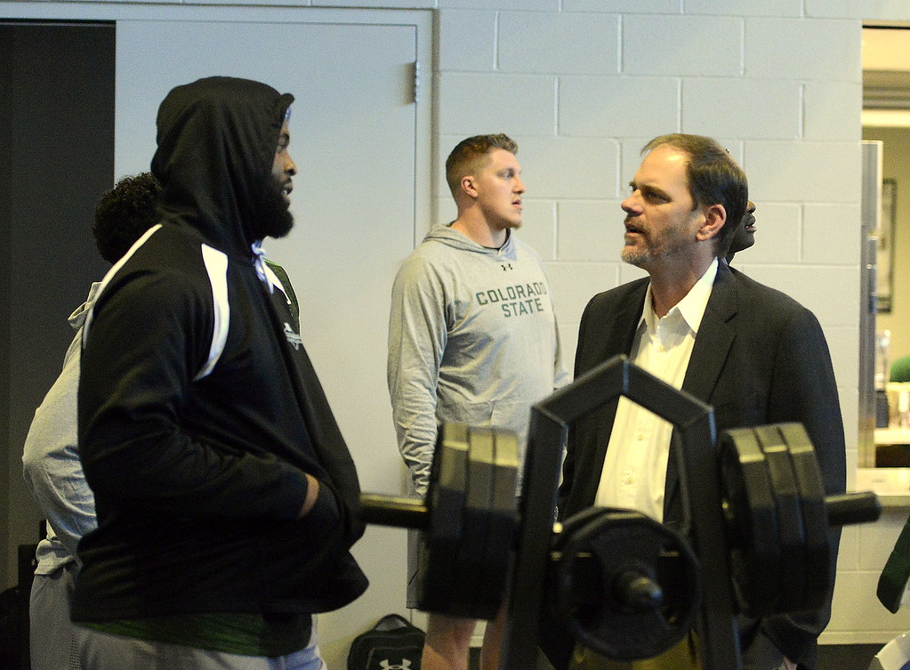 . Colorado State coach Mike Bobo talks to defensive lineman Darnell Thompson during the team\'s pro day on Wednesday. (Mike Brohard/Reporter-Herald)