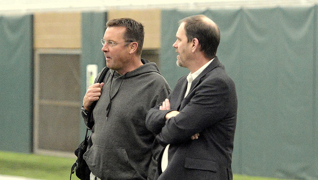 . Former Colorado State head coach and quarterback Steve Fairchild, left, talks with current CSU coach Mike Bobo during the team\'s pro day on Wednesday. Fairchild has been helping Nick Stevens prepare for the workout. (Mike Brohard/Reporter-Herald)