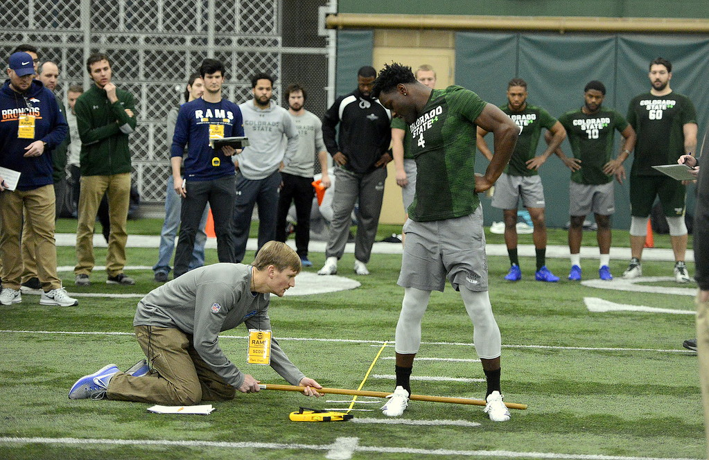 . Michael Gallup looks back for  his measurement in the broad jump during Colorado State\'s pro day on Wednesday. Gallup was measured at 9-foot-6. (Mike Brohard/Reporter-Herald)