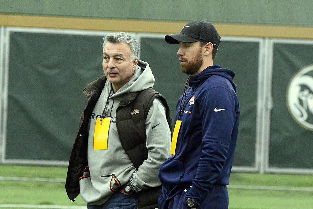 . Former Colorado State player Klint Kubiak, right, was part of the Denver Broncos\' contingent on hand to watch the Rams\' pro day workouts on Wednesday. (Mike Brohard/Reporter-Herald)
