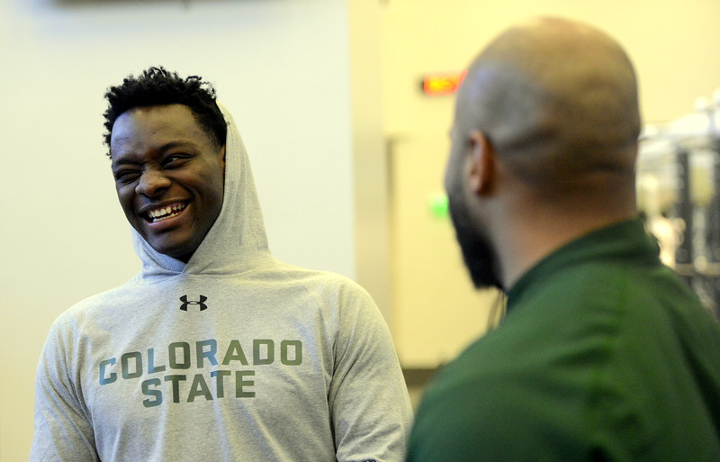 Michael Gallup laughs at Colorado State strength and conditioning coach Ryan Davis during the  team's pro day on Wednesday. (Mike Brohard/Reporter-Herald)