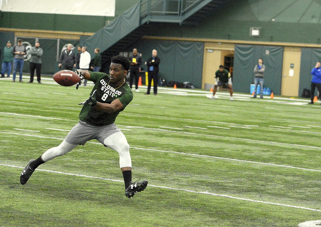 . Detrich Clark watches in a pass during individual drills at Colorado State\'s pro day on Wednesday. (Mike Brohard/Reporter-Herald)